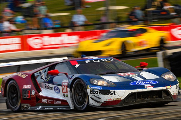 Elkhart Lake Wi August   Richard Westbrook And Ryan Briscoe Took The No  Ford Gt To The Top Of The Podium To Mark The Fourth Win In A Row For